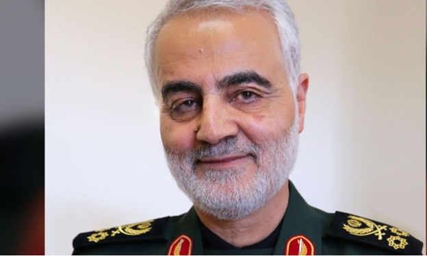 A man with short white beard in military uniform