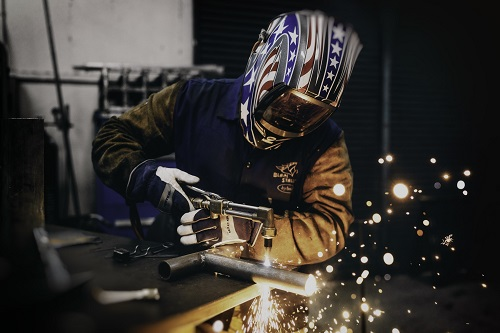 a man working on some iron tools to display how to make your skills stand out in a job interview