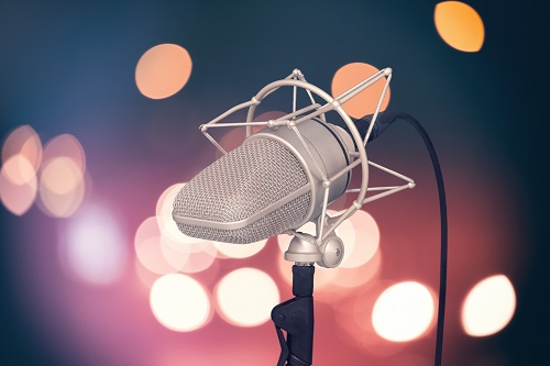 black and gray microphone with stand describing factors involved in voice quality