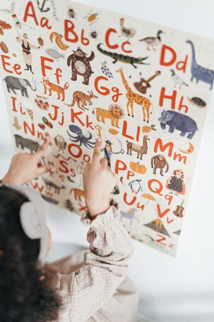 child reading english alphabet for reading comprehension