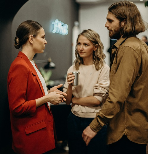 two women and man discussing Communication Skills in Your CV or interview