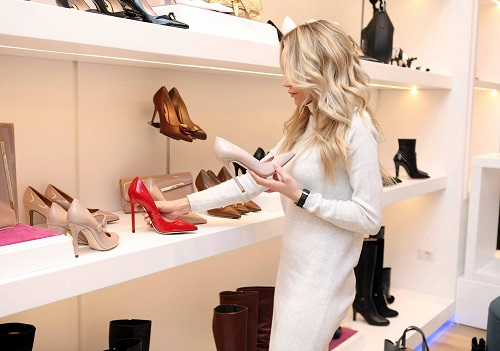woman at shoe store displaying which jobs require interpersonal skils