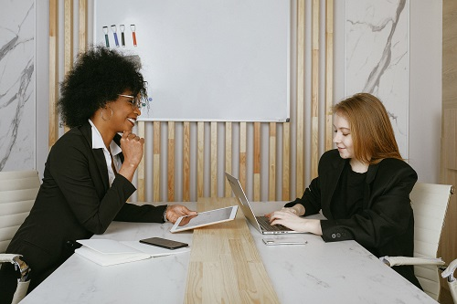 two women working types of listening skills in office