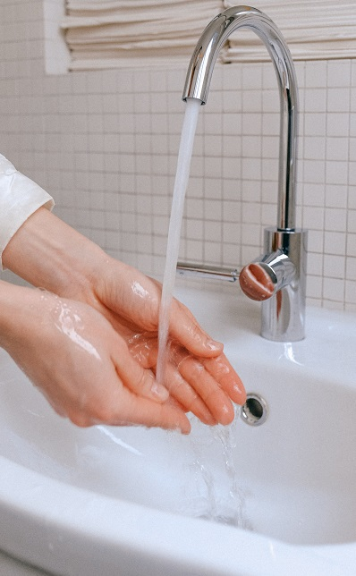 a person washing hands as the safety measures against coronavirus