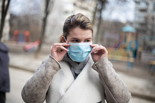 a woman wearing facemask as part of safety measures against Coronavirus