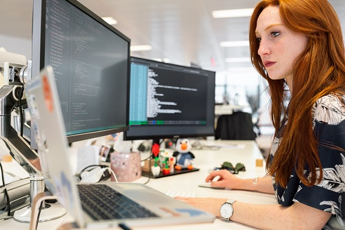 woman working on a computer exhibiting communication problems.