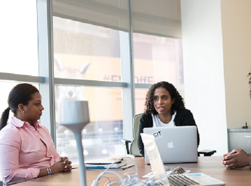 three woman discussing effective listening strategies