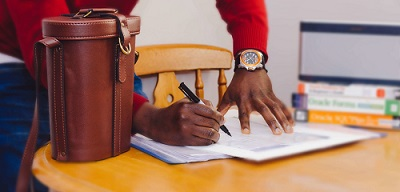 two hands with a pen and a note book writing Power Tips for writing