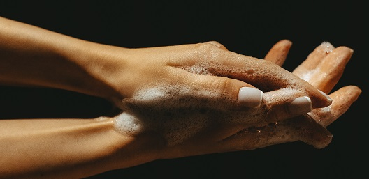 hands being washed to counter workplace safety hazards