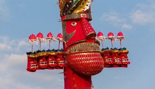 a red effigy about When is Dussehra