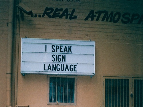 two gray stainless steel containers displaying Speaking | Importance of Speech |Purposes of Speech